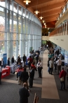 Attendees mingle and visit exhibitors in the Atrium.