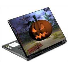 A laptop with a scary halloween pumpkin decal on the lid